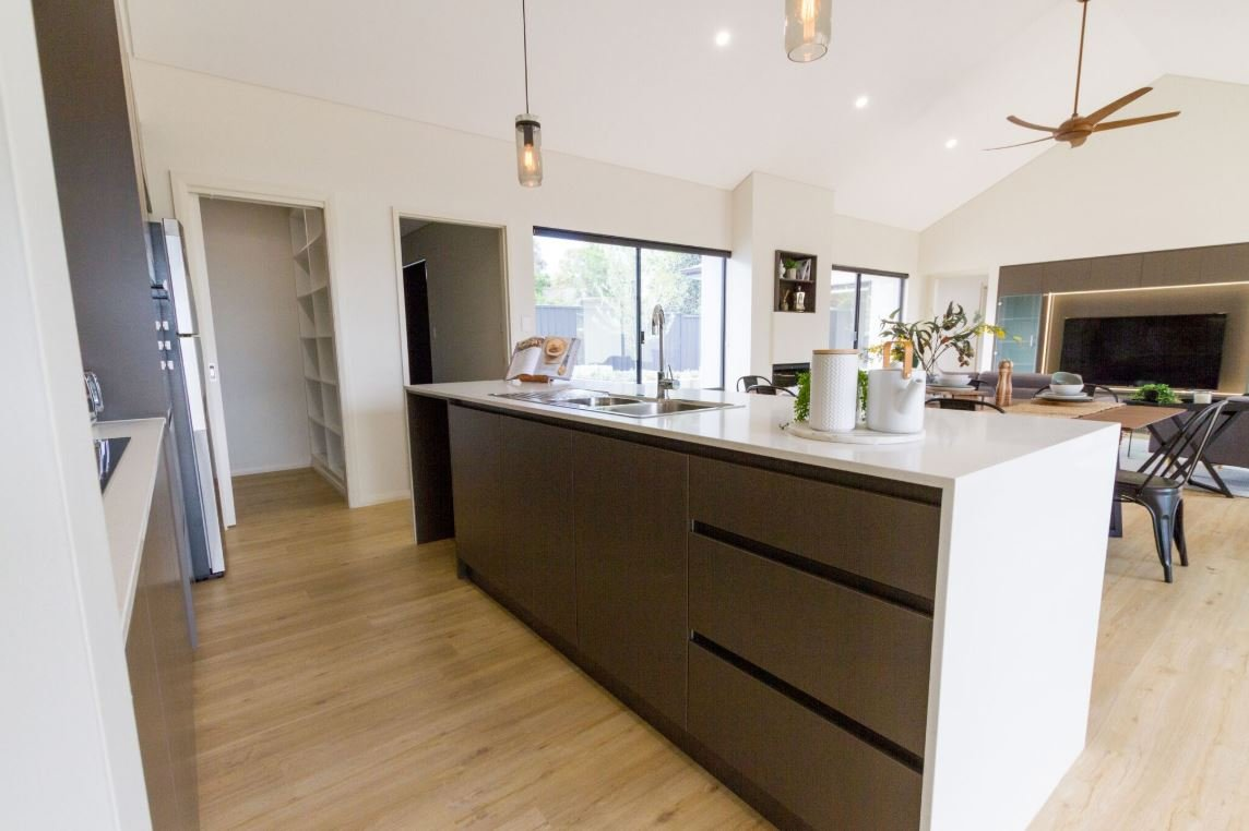 Kitchen Island with grey draws overlooking into dining room | Modular Homes Western Australia