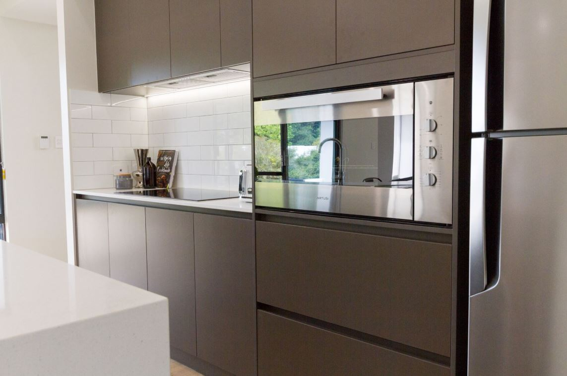 Kitchen with fridge and oven and grey draws and cabinets | Modular Homes Perth