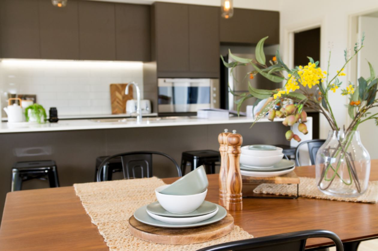 Snapshot of Dining Table with Black Chairs overlooking island | Home Builders Perth